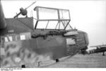 German DFS 230 glider with a MG 34 machine gun mounted on top of the aircraft and another stowed next to the cockpit, Italy, 1943; note Hs 126 aircraft in background