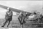 German glider troopers in exercise, charging from a DFS 230 glider upon landing, Italy, Sep 1943