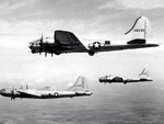 B-17 Flying Fortress bomber and B-29 Superfortress bomber in flight together during a test conducted by Boeing, circa late 1944, photo 3 of 3