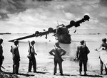 US Army troops looking at a wrecked H8K flying boat, Makin, Gilbert Islands, Nov 1943