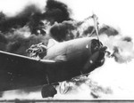 F6F-5 Hellcat fighter of US Navy pilot Ensign John G. Fraifogl caught on fire upon landing during USS Ticonderoga