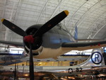 F6F-3 Hellcat fighter on display at the Smithsonian Air and Space Museum Udvar-Hazy Center, Chantilly, Virginia, United States, 26 Apr 2009, photo 2 of 4; note B-29 bomber Enola Gay in background