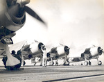 F6F Hellcat fighters of Fighting Squadron 6 warming up aboard USS Intrepid, 1944, photo 1 of 2