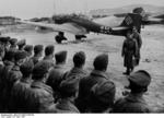 German Colonel General Erhard Milch inspecting Luftwaffe pilots, Trondheim, Norway, 23 Apr 1940; note Ju 87 Stuka dive bombers in background
