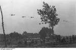 German Ju 87 Stuka dive bombers flying over German troops, Poland, Sep 1939