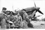 German pilots being briefed before a mission, Arras, France, May 1940; note Ju 87 Stuka aircraft in background