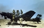 Australian soldiers on a wrecked German Ju 87B Stuka dive bomber, Libya, circa 1941