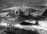 OS2U Kingfisher aircraft recovered alongside battleship Arizona, near US Territory of Hawaii, 6 Sep 1941, photo 1 of 2; note flag just forward of main pontoon