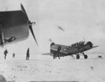US Navy OS2U Kingfisher aircraft immediately after landing in snow after a scouting mission in the North Atlantic, 2 Feb 1943; note squadron canine mascot