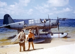 OS2U Kingfisher at the edge of the seaplane ramp at NAS Pensacola, Florida, United States, early 1941. Note Consolidated P2Y flying boat laying off shore, photo 2 of 2 (color)