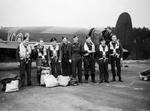 Wing Commander J. B. Tait (5th from left) with his crew in front of their Lancaster B Mk I (Special) bomber, RAF Woodhall Spa, Lincolnshire, England, United Kingdom, 13 Nov 1944
