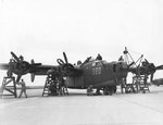 Mechanics at Laredo Army Air Field, Texas, US checked a B-24 bomber before its flight, 8 Feb 1944