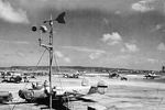 B-24J Liberator bombers, C-47 Skytrain transports, and B-29 Superfortress bombers at Kagman Field, Saipan, Mariana Islands, 1944