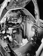 Close-up view of a P-38G Lightning aircraft cockpit, 23 Dec 1942; note the yoke rather than stick control and the bullet proof glass panel above the instrument panel. Photo 1 of 3.