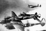 P-38H Lightning aircraft of 55th Fighter Group, US 38th Fighter Squadron over RAF Nuthamstead Airfield, England, United Kingdom, en route to attack Southern France, Feb-Apr 1944