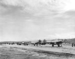Line of P-38 Lightning escort fighters at Jackson Field, Port Moresby, New Guinea, 1942-1943