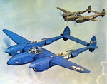 F-5B-1-LO Lightning aircraft (photo reconnaissance variant of the P-38J) painted PRU blue  in flight, 1943; photo 2 of 2; note accompanying P-38J aircraft in usual olive drab