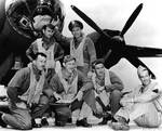 US Army Air Force First Lieutenant James Muri and his crew posing before their B-26 Marauder, Midway, Jun 1942