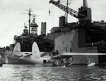 PBM-3 Mariner aircraft of US Navy patrol bomber squadron VPB-210 being prepared for hoisting aboard seaplane tender Albemarle, Guantanamo Bay, Cuba, 5 Jan 1945