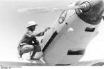 German crew painting a Bf 109E-4 fighter of JG 27, North Africa, 1941