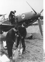 German armorers and mechanic working on a Bf 109 fighter of JG 20, 1939-1940