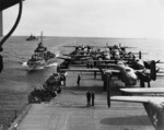 Aft flight deck of USS Hornet while en route to the launching point of the Doolittle Raid, Apr 1942; note USS Gwin and USS Nashville nearby