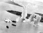 US B-25D bomber being destroyed by the blast of a bomb of a preceding friendly bomber, Hansa Bay, Australian New Guinea, 28 Aug 1943, photo 3 of 3