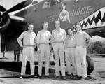 Actor Gary Cooper with pilots of 90th Squadron of USAAF 3rd Bomb Group and B-25D bomber