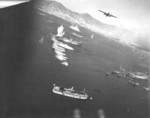 B-25 bomber attacking shipping in Victoria Harbour, Hong Kong, possibly during the 16 Oct 1944 raid by US 14th Air Force