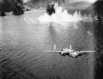 B-25D Mitchell bomber of the 13th Bomb Squadron departing Simpson Harbor after an attack, Rabaul, New Britain, 2 Nov 1943