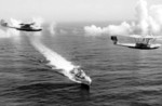 PBY-1 aircraft of US Navy squadron VP-11 and P2Y aircraft of VP-7 in flight over destroyer USS Dale, off San Diego, California, United States, 14 Sep 1936