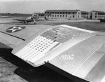 B-18 Bolo bomber port wing with low-drag experimental panel, Langley Field, Virginia, United States, 1 Jan 1941; note P-43 Lancer fighter in background