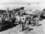 Australian troops with captured Morane-Saulnier MS.406 fighters and a Potez 630 bomber, Syria, Jul 1941