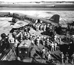 Wounded from Battle of Midway being offloaded from a C-53 variant of C-47 aircraft at Hickam Field, Oahu, US Territory of Hawaii, 7 Jun 1942; note Jeep and WC-9 ambulance