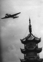 DC-2 passenger aircraft of China National Aviation Corporation on its maiden flight, over the pagoda of Longhua Temple, Shanghai, China, May 1935