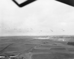 C-47 Skytrain aircraft of US 101st Airborne Division dropping supplies to troops of US 4th Division, Briealf, Germany, 13 Feb 1945