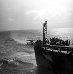 SOC Seagull aircraft being recovered by cruiser Philadelphia, off North Africa, Nov 1942, photo 1 of 4