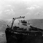 SOC Seagull aircraft being recovered by cruiser Philadelphia, off North Africa, Nov 1942, photo 3 of 4