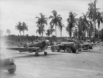 Two No. 79 Squadron RAAF Spitfire aircraft and ground crew at Momote Airfield, Los Negros Island, Admiralty Islands, circa Apr 1944