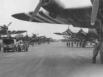 UK Royal Air Force Stirling bombers, acting as glider tugs, lining at the runway at Tarrant Rushton, England, United Kingdom, May-Jun 1944; note invasion strips