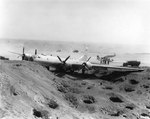 B-29 crash-landed on Motoyama Airfield, Iwo Jima, Bonin Islands, after fighters disabled two engines on a bombing run over Osaka, 10 Mar 1945. Photo 1 of 2.
