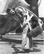 WASP pilot Deanie (Bishop) Parrish in front of her P-47 Thunderbolt aircraft, circa early 1940s