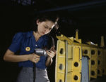 A female Vultee Aircraft Corporation employee working on the horizontal stabilizer for a Vengeance dive bomber, Nashville, Tennessee, United States, Feb 1943