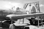 P-40E Kittyhawk fighter under maintenance, China, date unknown