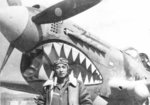 Chinese pilot Yoh Kung Chen of 27th Fighter Squadron of 5th Fighter Group of the Chinese-American Composite Wing (Provisional) with his P-40 Warhawk fighter, China, 1943-1945