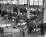 P-40 fighters at a repair depot in China, date unknown; note Flying Tigers emblem and Republic of China roundrel