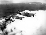 African-American US Army pilots flying P-40 Warhawk fighters over Selfridge Field, Michigan, United States, circa 28 Jun-14 Sep 1943