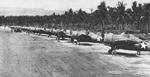 F4F Wildcat fighters of the US Navy and US Marines lined up on Henderson Field on Guadalcanal, Solomon Islands, Jan 1943, photo 1 of 2