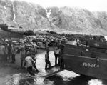American soldiers unloading landing craft on the beach at Massacre Bay, Attu, Aleutian Islands, 13 May 1943