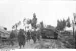 German troops on a road near Nettuno, Italy, Mar 1944; note Ferdinand/Elefant tank destroyer